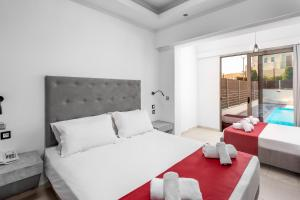 A bed or beds in a room at Delfinia Resort - All Inclusive