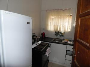 A kitchen or kitchenette at Tranquil Home