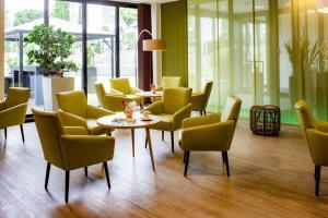 Ein Sitzbereich in der Unterkunft Friendly Cityhotel Oktopus