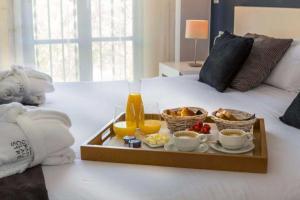 Cama o camas de una habitación en Hotel Gran Claustre Restaurant & Spa