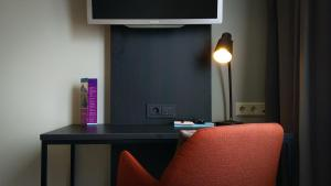 Телевизор и/или развлекательный центр в Quality Hotel Augustin