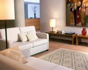 A seating area at Hotel Aquadulci