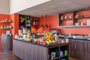 Restaurant ou autre lieu de restauration dans l'établissement Best Western Premier Masqhotel