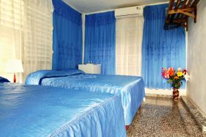 A bed or beds in a room at Villa Tres Hermanas