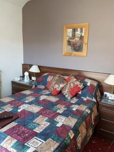 A bed or beds in a room at Karden House