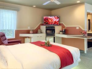 Кровать или кровати в номере Motel La Cheminée