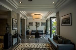 El vestíbulo o zona de recepción de The Cyclo Siem Reap Hotel