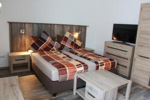 A bed or beds in a room at Aparts Oberhausen
