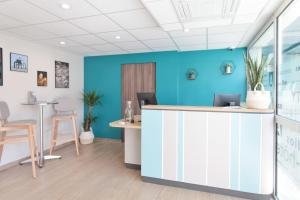 The lobby or reception area at Appart'City La Rochelle