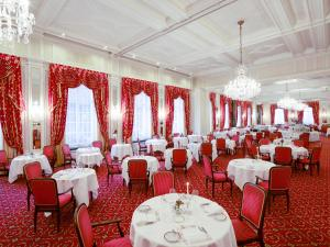 A restaurant or other place to eat at Kulm Hotel St. Moritz