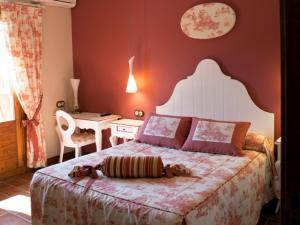 Cama o camas de una habitación en Hotel La Parra