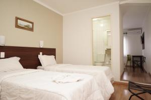 Кровать или кровати в номере Hotel Nelo