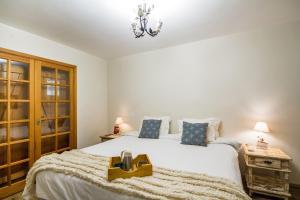 Cama ou camas em um quarto em Pousada Da Pedra