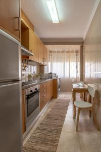 A kitchen or kitchenette at O Veleiro by MP