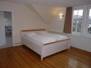 """Ein Bett oder Betten in einem Zimmer der Unterkunft Garni - Hotel """"Unsere Stadtvilla"""""""