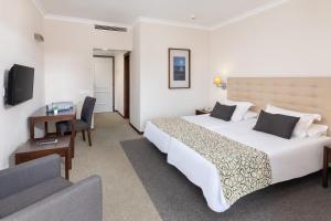 Een bed of bedden in een kamer bij Hotel El Tope