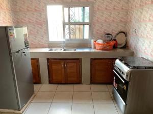 A kitchen or kitchenette at Villa contemporaine