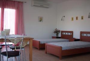 Ένα ή περισσότερα κρεβάτια σε δωμάτιο στο Maistrali