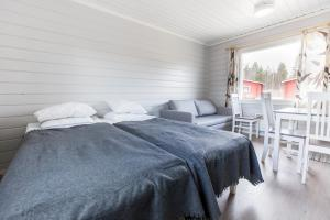 A bed or beds in a room at Holiday Village Inari