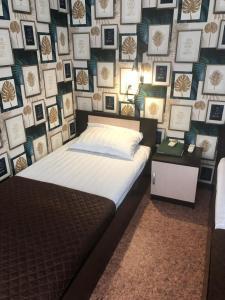 Кровать или кровати в номере Отель «Тибет»