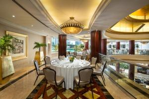 A restaurant or other place to eat at Beach Rotana - Abu Dhabi