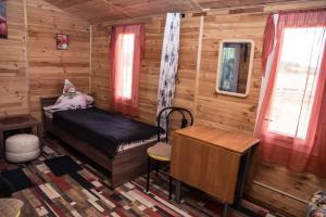 Кровать или кровати в номере Happy little house