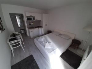 Кровать или кровати в номере Apartments Kuca.House