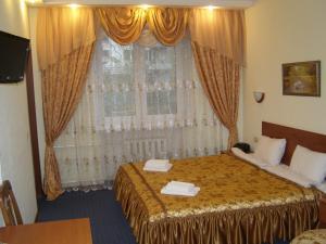 Кровать или кровати в номере Отель Бригантина