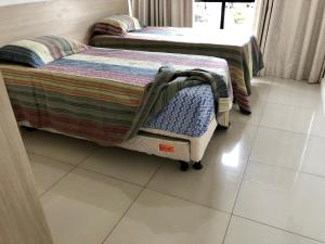 A bed or beds in a room at Ondina Apart