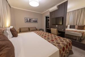 A bed or beds in a room at Class Hotel Rio Claro