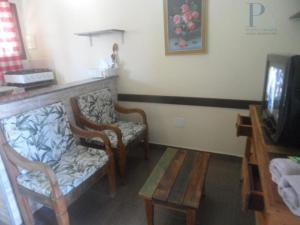 Cama ou camas em um quarto em Apartamentos Mosaico