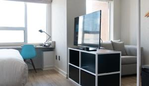 A television and/or entertainment center at Bond Place Hotel