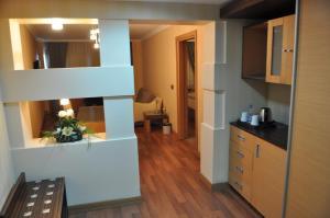 A kitchen or kitchenette at Surmeli Adana Hotel