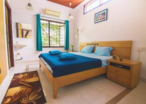 A bed or beds in a room at Zostel Mysore