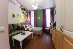 Гостиная зона в Волшебные апартаменты Чеширский Кот
