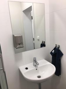 A bathroom at AeroRooms