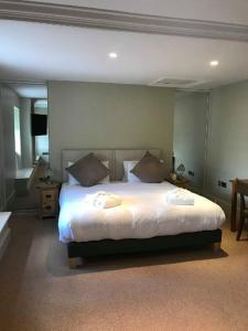A bed or beds in a room at Slebech Park Estate