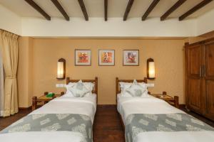 A bed or beds in a room at Hotel Thamel House