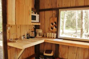 Köök või kööginurk majutusasutuses Kuuli Puhkemajad