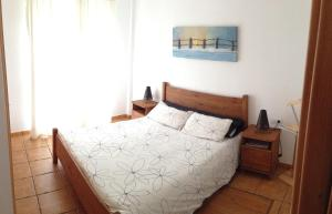 A bed or beds in a room at Casa Rosaire