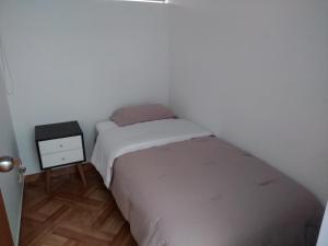 A bed or beds in a room at Departamento en el centro de San Borja (Rubens)