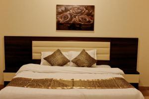 Cama ou camas em um quarto em Al Reehan Homes - Bawadi