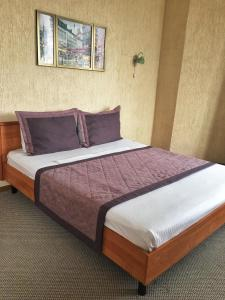Кровать или кровати в номере Мини гостиница Старый Причал