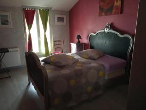 Un ou plusieurs lits dans un hébergement de l'établissement Les attelages de la fontaine