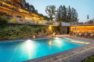 The swimming pool at or near Alp Wellness Sport Hotel Panorama