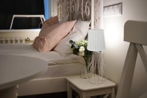 Кровать или кровати в номере Апарт-отель S12