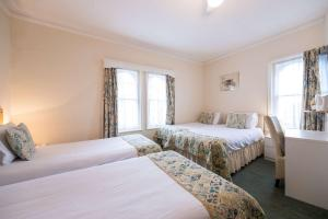 A bed or beds in a room at Comfort Hotel Great Yarmouth