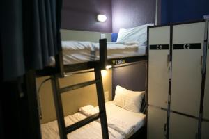 A bunk bed or bunk beds in a room at D-Well Hostel