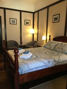 A bed or beds in a room at The Rosary