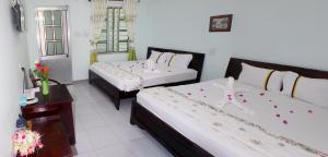 Cama o camas de una habitación en Quoc Dinh Guesthouse